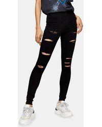 TOPSHOP – Joni – Jeans mit ausgeprägten Zierrissen - Schwarz