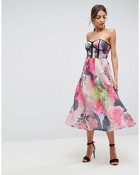 ASOS - Vestito da cerimonia midi a fascia in tessuto a rete accoppiato con stampa floreale - Lyst