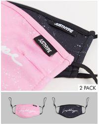 Hype Pack de 2 mascarillas en negro y rosa con tiras ajustables y estampado moteado exclusivo de