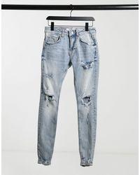 Bershka – Supereng geschnittene Jeans mit Acid-Waschung - Blau