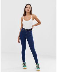 ASOS – Ridley – Enge Jeans mit hohem Bund - Blau