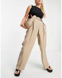 Mango Pantaloni sartoriali a fondo ampio cammello - Neutro