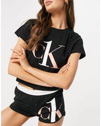 Calvin Klein CK One - Pigiama con T-shirt e pantaloncini nero con logo