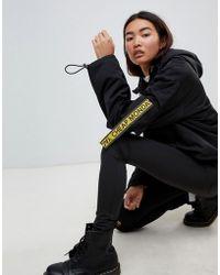 Cheap Monday Anorak court avec nombreuses poches et bandes logo - Noir