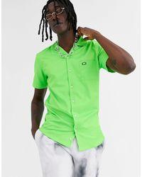 Criminal Damage Camisa con cuello con solapas en verde neón