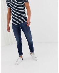 Emporio Armani J06 - Schmal geschnittene Jeans in heller Waschung - Blau