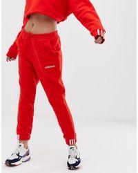 adidas Originals Coeeze - Pantalon de jogging - Rouge