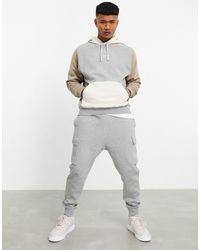 Nike - Felpa con cappuccio grigio scuro multicolore colorblock - Lyst