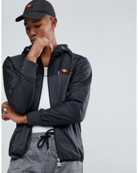 Ellesse - Poly Tricot Jacket With Quilted Hood In Black - Lyst