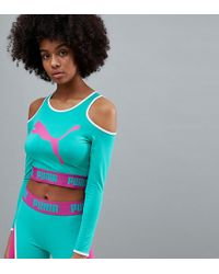 PUMA - Exclusive To Asos Long Sleeve Cut Out Crop In Green - Lyst