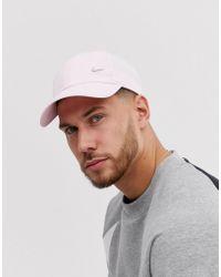 Nike Gorra rosa con logo metalizado