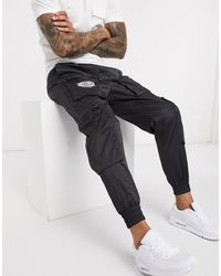 The Couture Club Nylon Cargo Trousers With 3d Pockets - Black