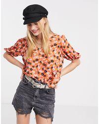 ONLY – Orange Bluse mit Puffärmeln und Blumen-Print - Mehrfarbig