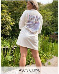 ASOS Vestido estilo camiseta extragrande en tono crema paradise valley - Multicolor