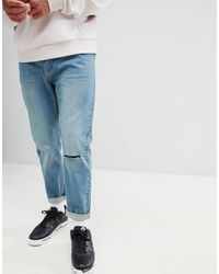 Bellfield Carrot Fit Jeans With Knee Rip - Blue