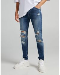 Bershka Super Skinny Jeans With Rips And Freyed Hem - Blue