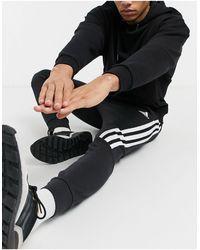 adidas Originals Adidas - Joggers neri con fettuccia con 3 strisce - Nero