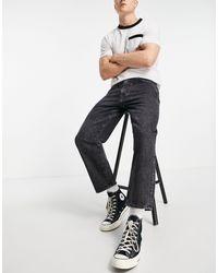 Levi's – Stay Loose – Schmal zulaufende Jeans mit kurzem Schnitt - Schwarz
