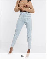 Missguided - Mom jeans con fondo grezzo lavaggio azzurro - Lyst