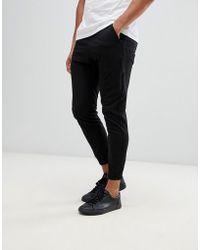 Religion Pantalones cargo ajustados en negro