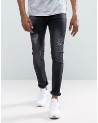 Just Junkies Sicko Slim Fit Jeans With Rips In Washed Black