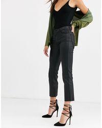 Vero Moda - – Beschichtete Schlag-Jeans - Lyst