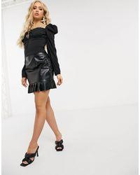 Naanaa Jupe en imitation cuir avec basque et volants - Noir