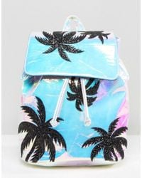 Skinnydip London - Cracked Iridescent Backpack With Glitter Palm Detail - Lyst