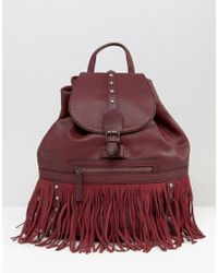 Glamorous Drawstring Backpack With Stud And Fringe Detail - Red