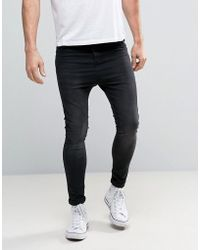 Illusive London - Super Skinny Jeans In Black With Dropped Crotch - Lyst
