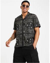 River Island Camisa negra con estampado - Negro