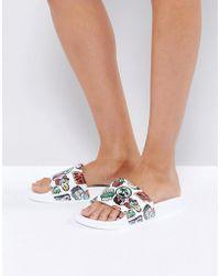 Slydes Blinky Multi Badge Print Slide Flat Sandals - Multicolor