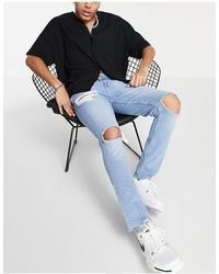 ASOS Skinny Jeans With Heavy Rips And Raw Hem - Blue