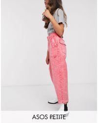 ASOS ASOS DESIGN Petite - Pantaloni casual a palloncino lavaggio acido corallo con cintura - Rosso