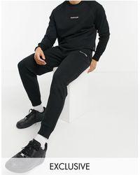 Calvin Klein Joggers negros ck con logo invertido exclusivo en ASOS