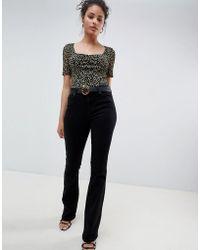 Miss Selfridge - Skinny Flare Jean In Black - Lyst