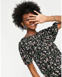 ONLY – Bluse mit Rückenausschnitt und Blümchenmuster - Schwarz