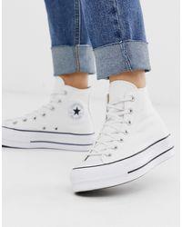Converse Zapatillas hi-top en blanco con logo extragrande Chuck Taylor All Star