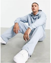 ASOS Tracksuit With Oversized Hoodie And Super Oversized sweatpants With toggles - Blue