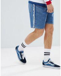 ASOS - Design Denim Shorts In Skater Fit Vintage Mid Wash With Frayed Side Stripe - Lyst