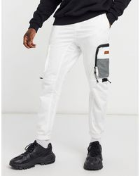 Bershka Jogger cargo à poches multiples - Blanc