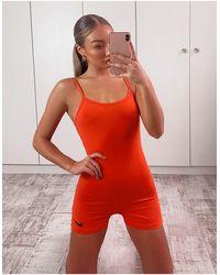Nike Tuta aderente rossa con logo - Arancione