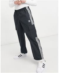 adidas Originals - Черные Брюки С Тремя Полосками И Карманом Карго Adicolor-черный Цвет - Lyst