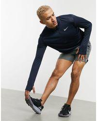 Nike Pacer - Top a maniche lunghe con zip corta blu navy