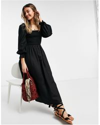 New Look Vestido midi negro fruncido con acabado texturizado