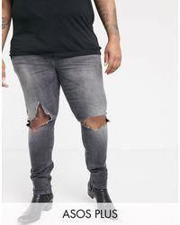 ASOS Vaqueros muy ajustados en negro desgastado vintage con rodillas rasgadas