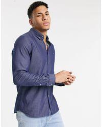 Lacoste Camisa de corte estándar con diseño texturizado de popelina de - Azul