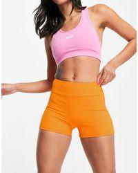 South Beach Shorts naranjas ajustados deportivos