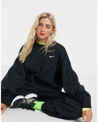 Nike – er Oversize-Kapuzenpullover mit kleinem Swoosh-Logo - Schwarz