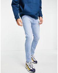 TOPMAN Big & Tall - Jean skinny stretch en coton biologique mélangé - Délavage clair - Bleu